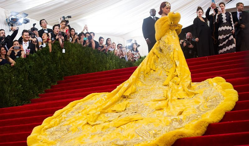 Rihanna wearing the Guo Pei designed dress, as she arrives at the Met Gala 2015 (Image via Charles Sykes/Invision/AP)