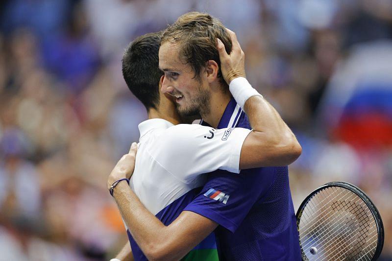Novak Djokovic (L) & Daniil Medvedev embrace after the 2021 US Open final