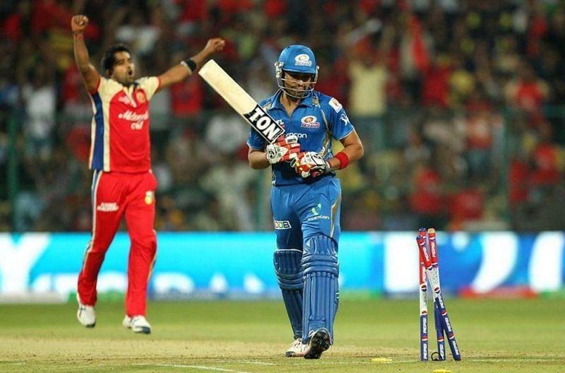 Vinay Kumar enjoys the dismissal of Rohit Sharma during IPL 2013 (Image Courtesy: IPLT20.com)