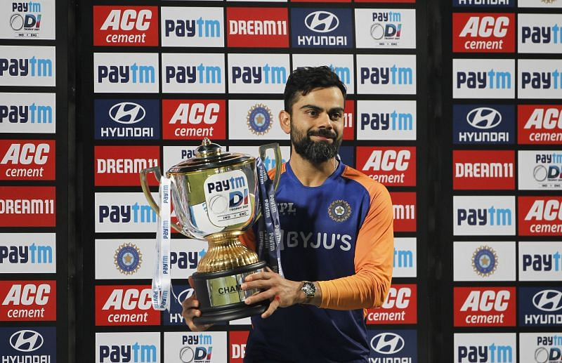 Virat Kohli poses with the trophy after India's series win over England.