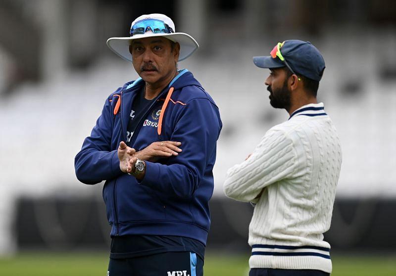 Ajinkya Rahane of India speaks with coach Ravi Shastri during a nets session at The Kia Oval