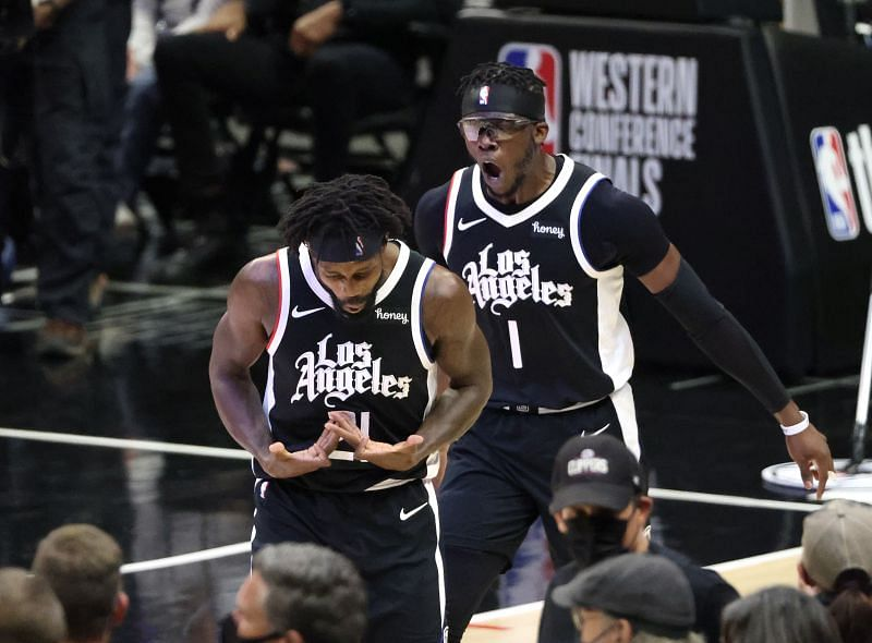 Patrick Beverley (#21) of the LA Clippers celebrates a three-point basket with Reggie Jackson (#1) during the 2021 NBA Western Conference Finals.