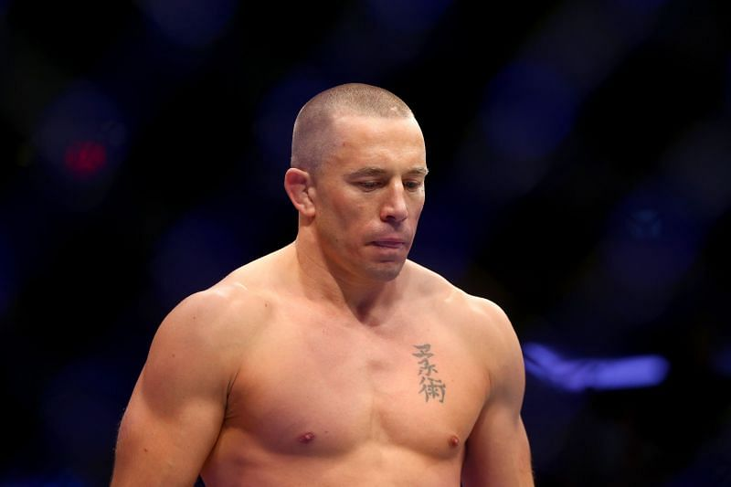Georges St-Pierre commented on Oscar De La Hoya pulling out of his fight against Vitor Belfort.