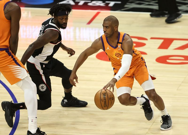 Chris Paul uses the screen to get past Patrick Beverley