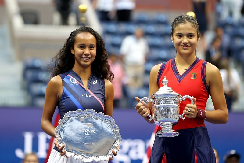 Leylah Fernandez and Emma Raducanu with their respective trophies