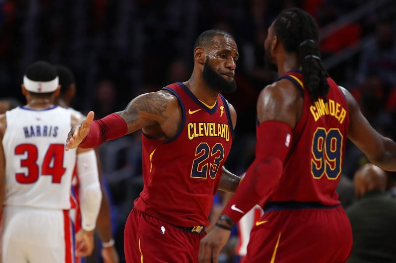 LeBron James #23 of the Cleveland Cavaliers celebrates a first half three point basket with Jae Crowder #99 while playing the Detroit Pistons at Little Caesars Arena on November 20, 2017 in Detroit, Michigan. Cleveland won the game 116-88.