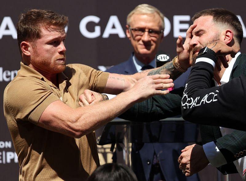 Canelo Alvarez slaps Caleb Plant during a press conference