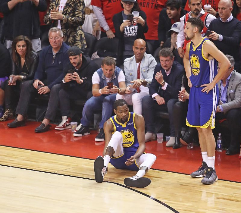 Kevin Durant #35 of the Golden State Warriors goes down with an apparent achilles injury during action against the Toronto Raptors in Game Five of the 2019 NBA Finals at Scotiabank Arena on June 10, 2019 in Toronto, Canada.
