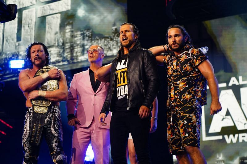 Adam Cole with The Elite Faction