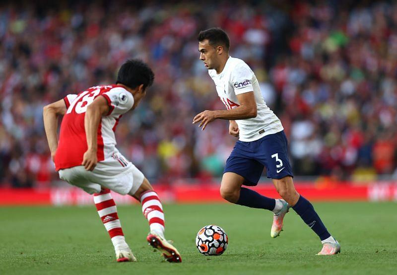 Arsenal defender Takehiro Tomiyasu faces up against Spurs' Sergio Reguilon (right).