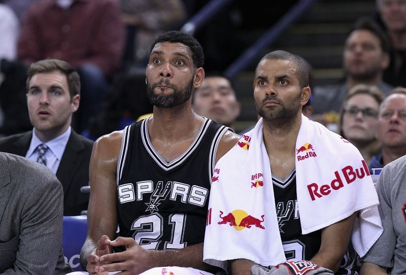 Tim Duncan #21 and Tony Parker #9 of the San Antonio Spurs