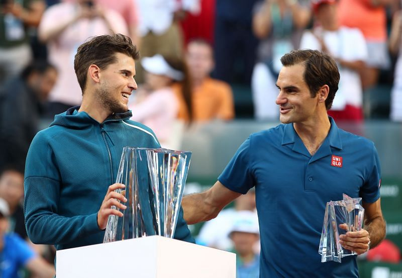 Dominic Thiem (L) and Roger Federer at the 2019 BNP Paribas Open
