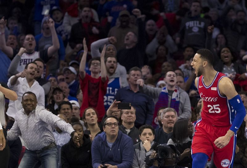 Ben Simmons reacts after dunking the ball during an NBA game.