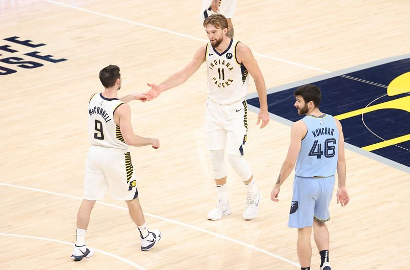 Domantas Sabonis and TJ McConnell of the Indiana Pacers