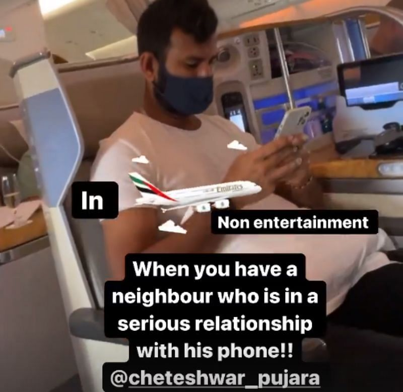Cheteshwar Pujara is busy on his phone.