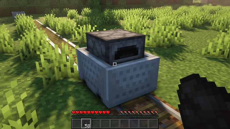 A minecart with a rail can be powered using coal and charcoal (Image via Minecraft)
