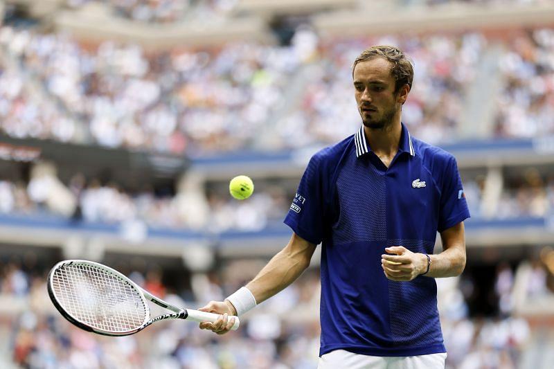 Daniil Medvedev prepares to serve against Novak Djokovic