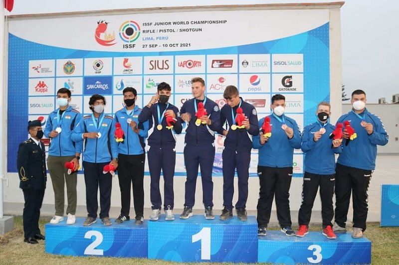 The Indian shooting men's junior trap team on the podium.