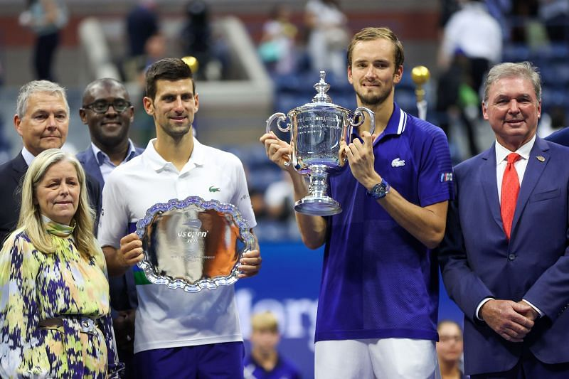 Novak Djokovic and <a href='https://www.sportskeeda.com/player/daniil-medvedev' target='_blank' rel='noopener noreferrer'>Daniil Medvedev</a> with their respective trophies at the 2021 US Open