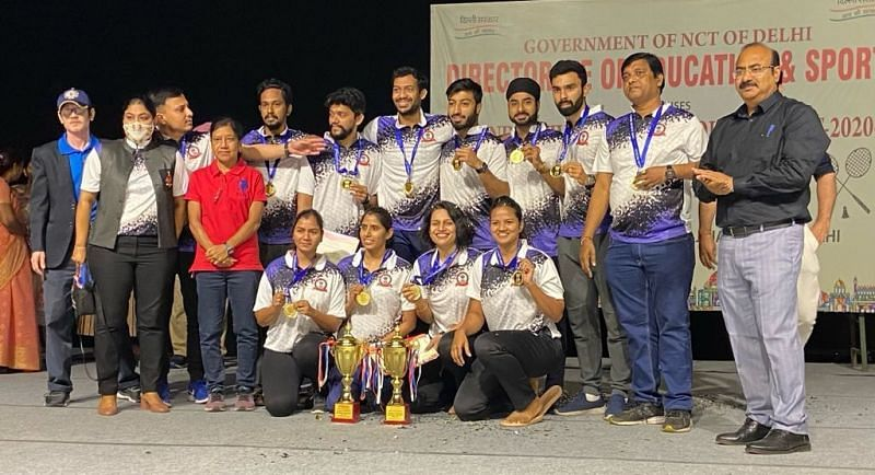 RSB Mumbai shuttlers with their trophies and medals in New Delhi on Thursday