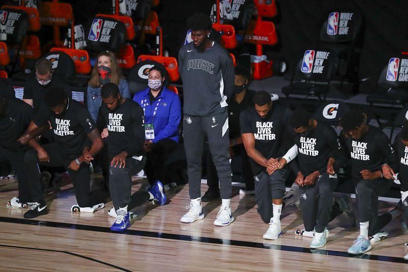 Orlando Magic power forward Jonathan Isaac standing during the national anthem