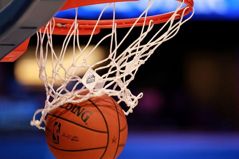 A detail of an official Spalding basketball going through the net with an official logo of the 2012 Orlando NBA All-Star Game