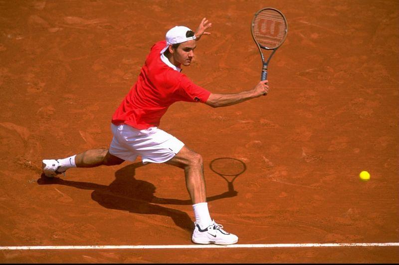 A teenaged Roger Federer in action on tour