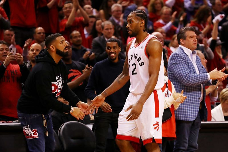 Singer and rapper Drake high-fives Kawhi Leonard during an NBA Playoffs game