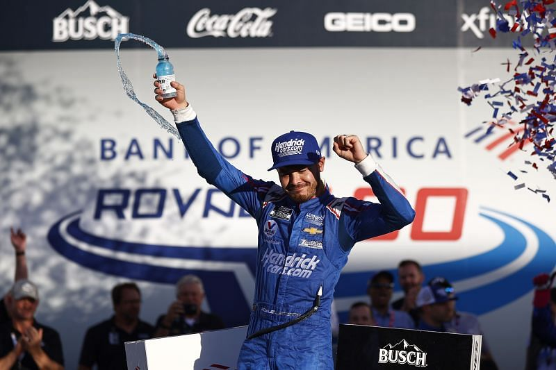 Kyle Larson, driver of the #5 HendrickCars.com Chevrolet, celebrates in victory lane after winning the NASCAR Cup Series Bank of America ROVAL 400 at Charlotte Motor Speedway on October 10, 2021 in Concord, North Carolina. (Photo by Jared C. Tilton/Getty Images)