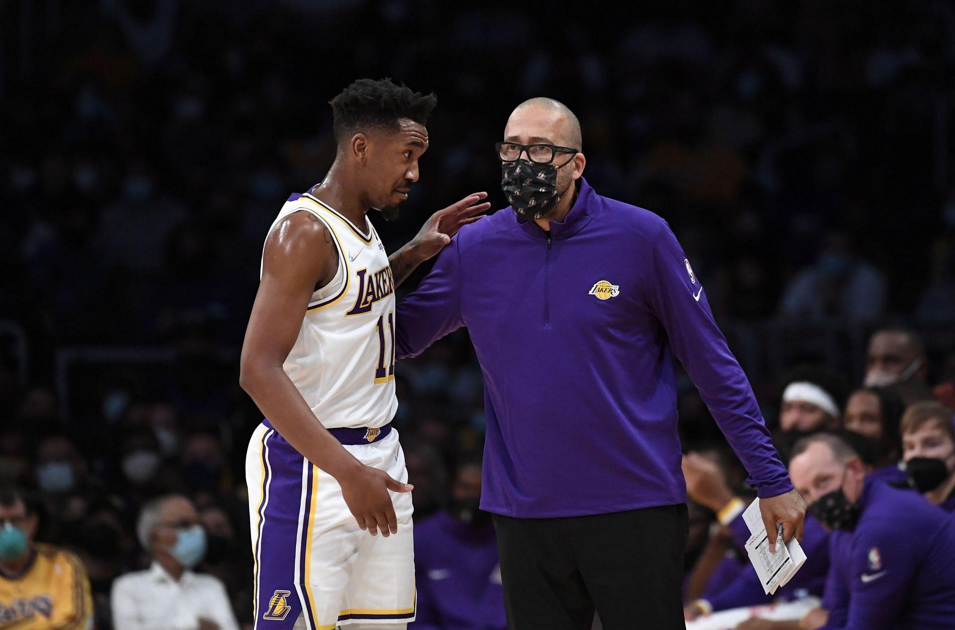 LA Lakers' Malik Monk walks to the bench during an NBA game.