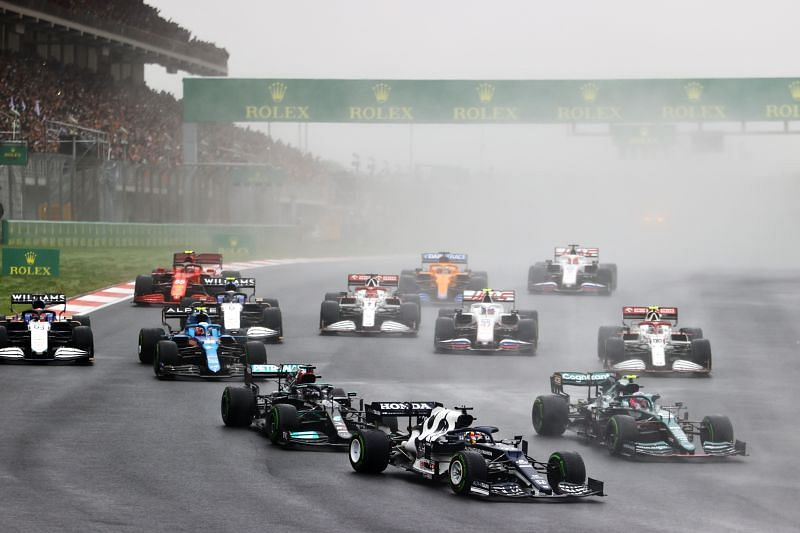 Yuki Tsunoda of Japan leads Sebastian Vettel of Germany driving and Lewis Hamilton at the start during the 2021 Turkish Grand Prix at Intercity Istanbul Park , Turkey. (Photo by Bryn Lennon/Getty Images)