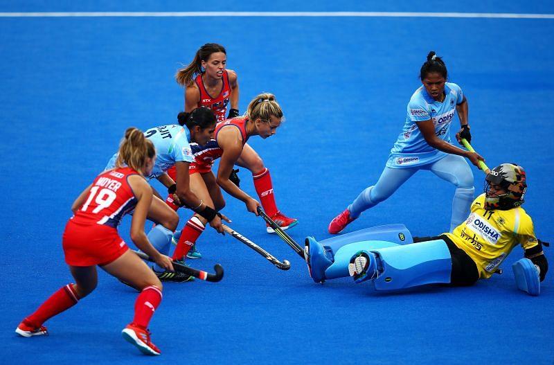 Indian goalkeeoer Savita Punia thwarts an attempt on goal.