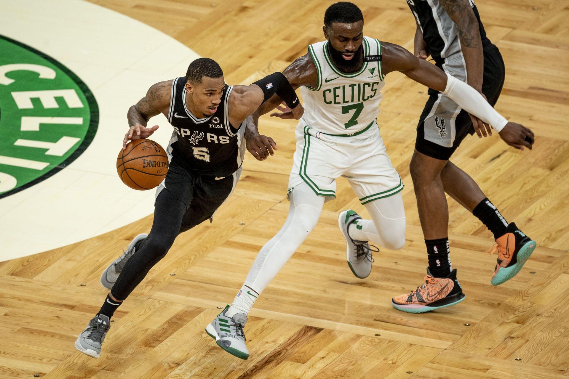 Dejounte Murray driving past Jaylen Brown of the Celtics