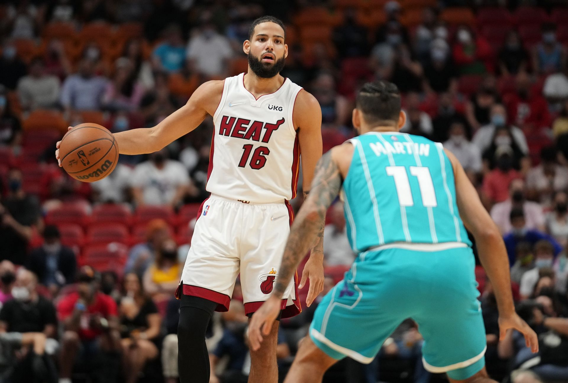Caleb Martin goes head to head against Cody Martin in the Miami Heat vs Charlotte Hornets matchup