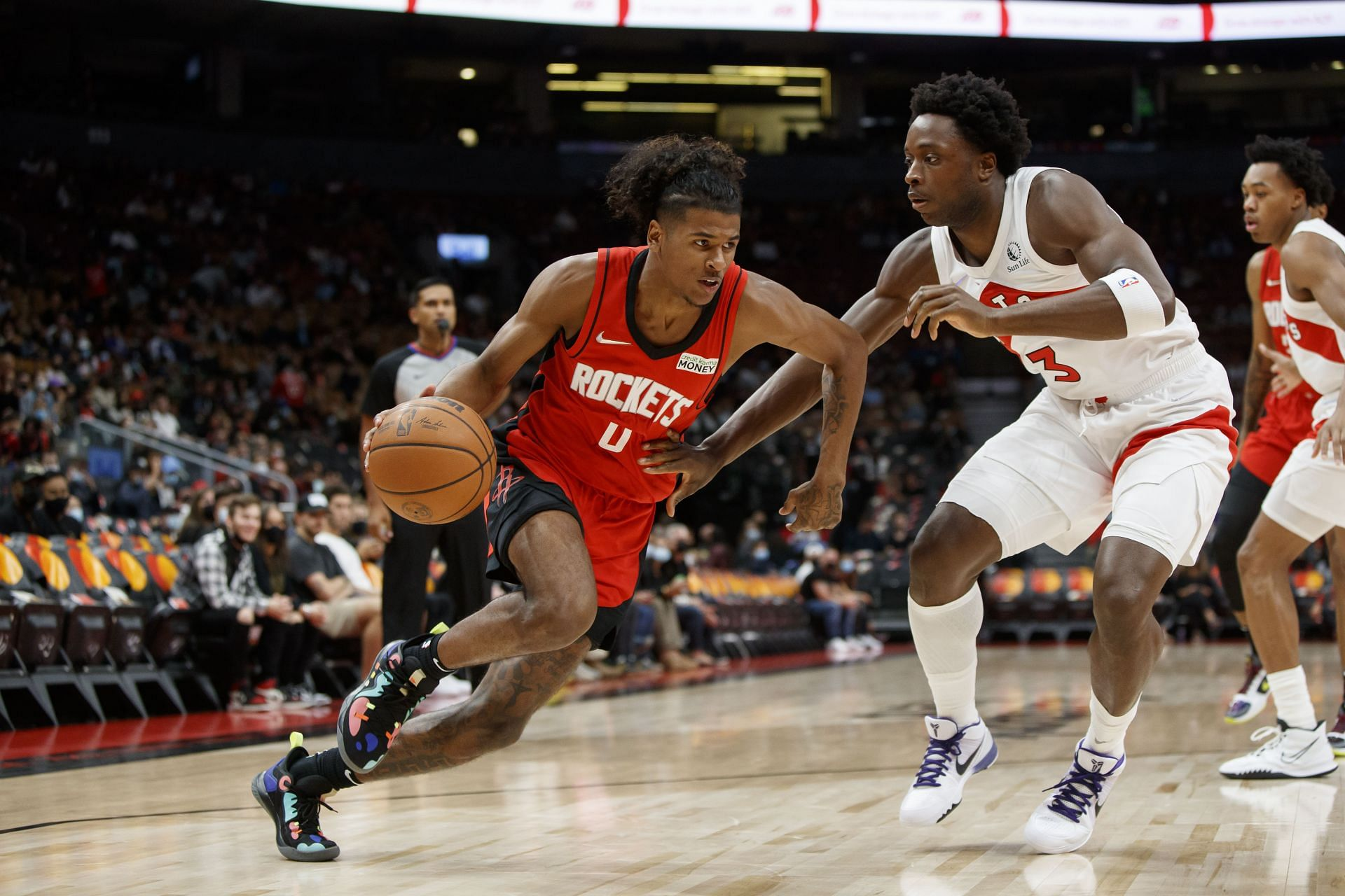 Houston Rocket's guard Jalen Green drives into the paint against OG Anunoby.