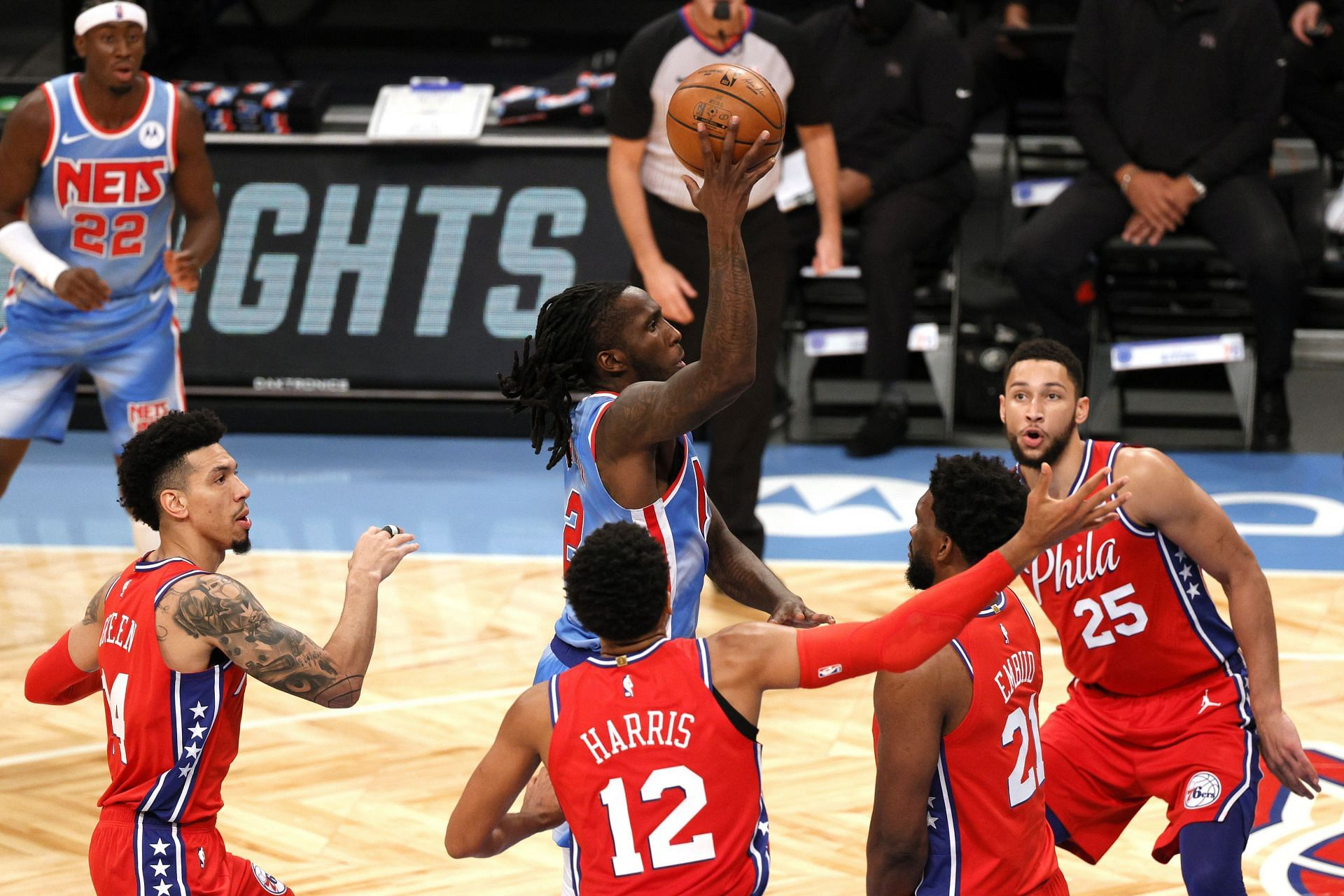 The Philadelphia 76ers' defense gang up on a drive in a game against the Brooklyn Nets last season.