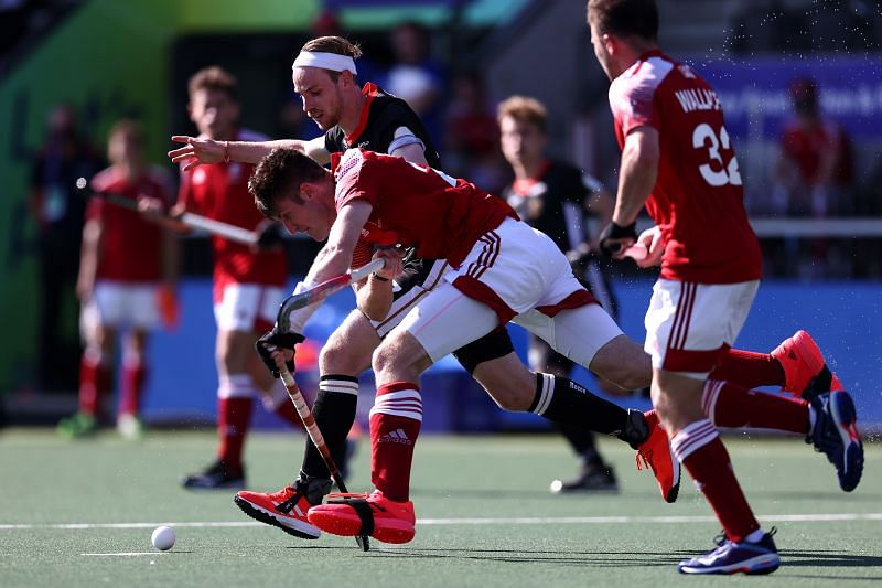The England Men's Hockey Team (Red) against Germany