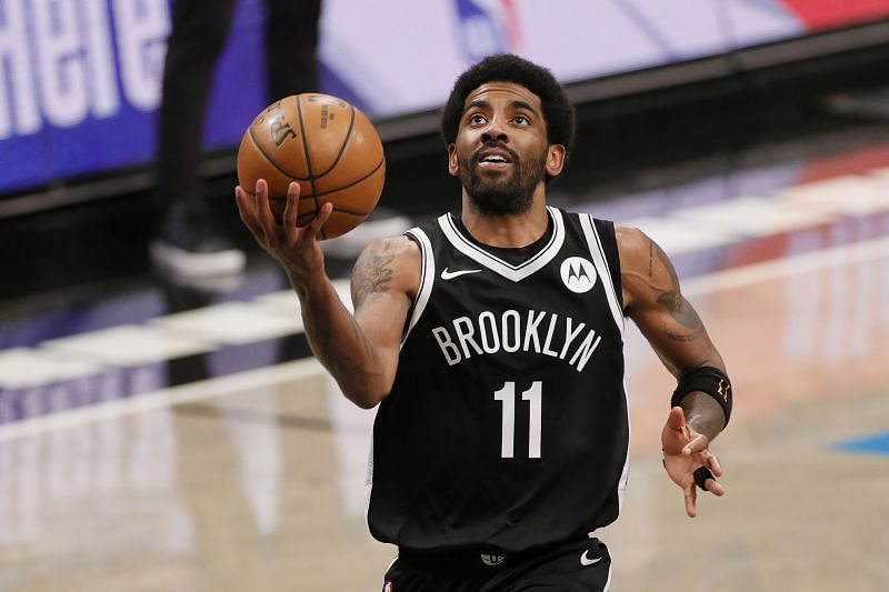 Brooklyn Nets guard Kyrie Irving taking a layup in a home game last season