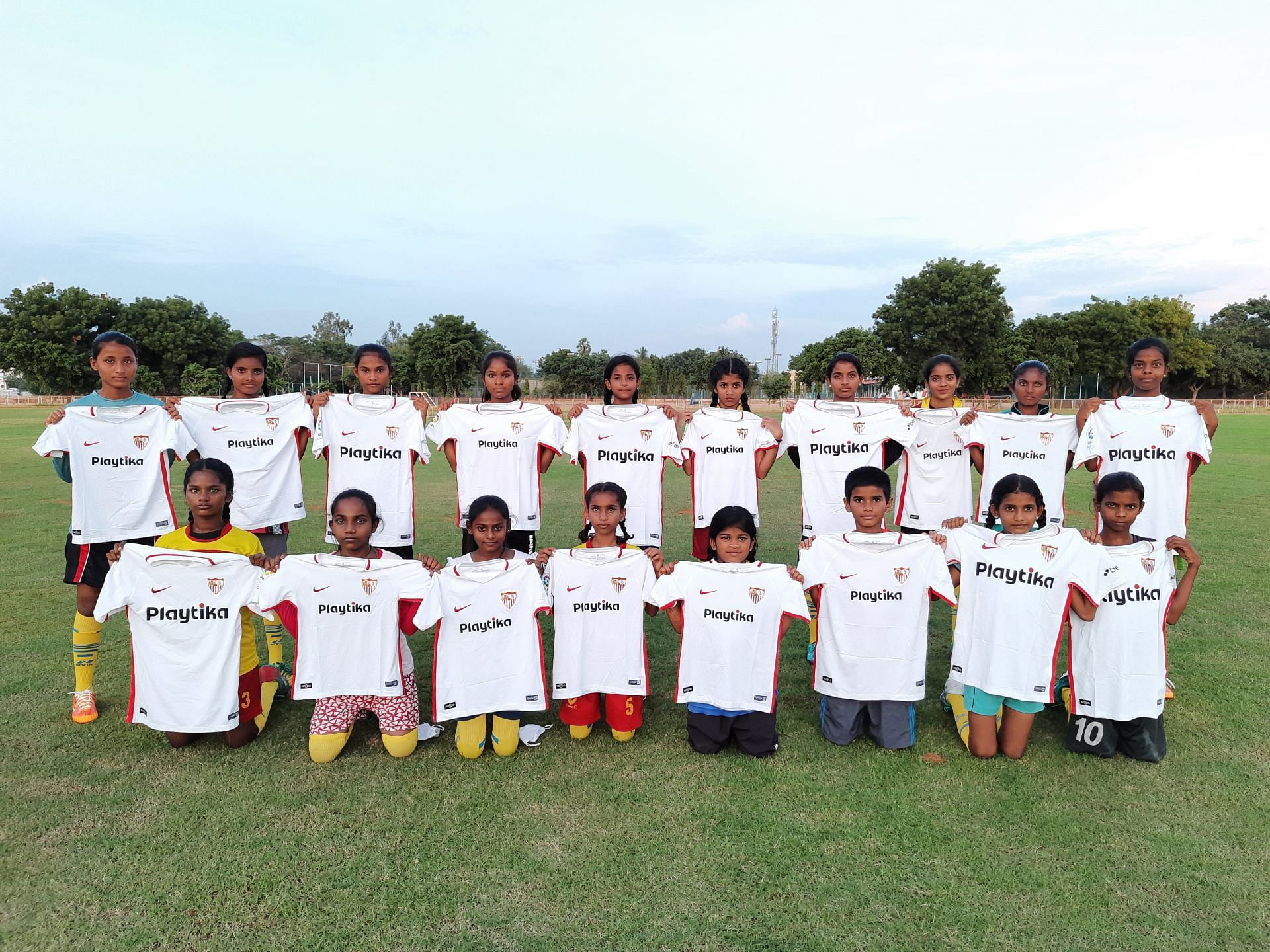 Official Sevilla FC jerseys in the Anantapur Rural Football League.