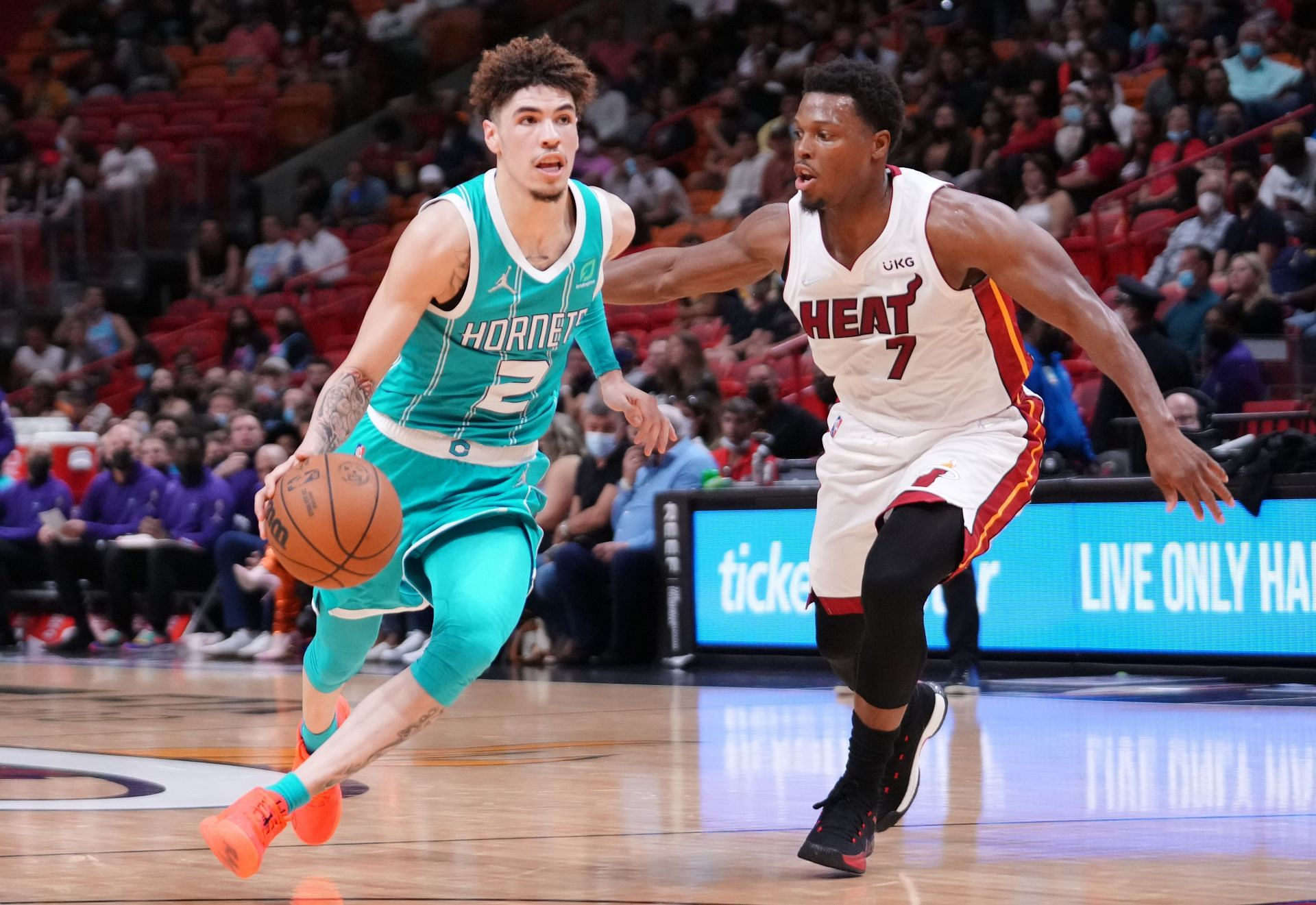 LaMelo Ball of Charlotte Hornets guarded by Kyle Lowry (#7) of the Miami Heat
