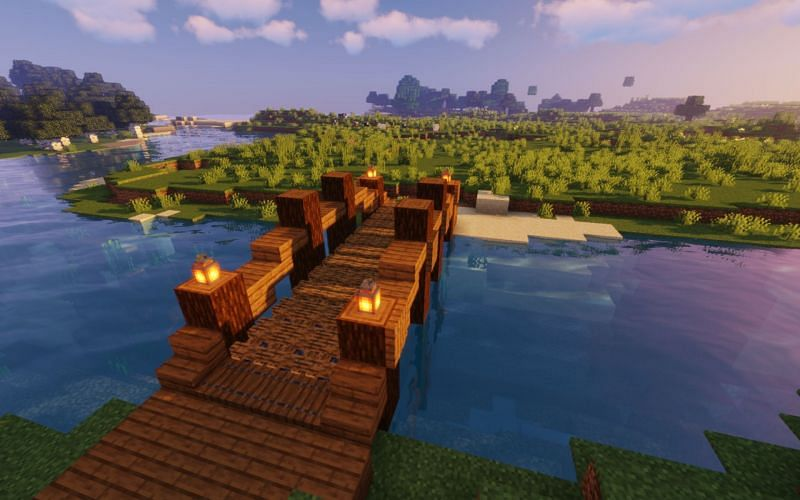 An image of a bridge that a player has made out of waterlogged campfires (Image via Minecraft)
