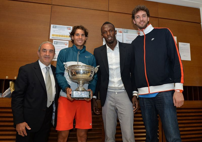 Rafael Nadal, Usain Bolt, and Pau Gasol pose with the 2013 French Open trophy
