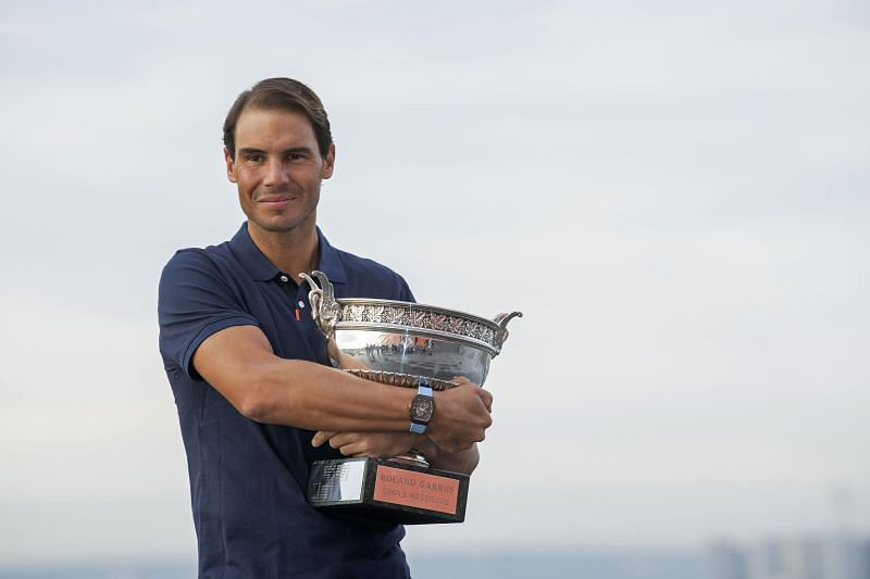 Rafael Nadal posing with the 2021 Roland Garros trophy at the Eiffel Towe