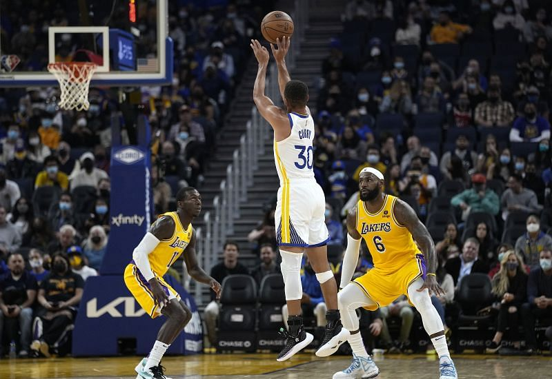 Stephen Curry of the Golden State Warriors shoots over the LA Lakers' LeBron James