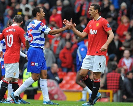 Anton Ferdinand shakes hands with brother Rio (R) in April