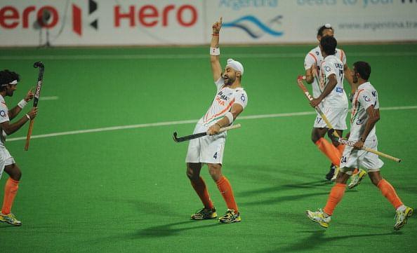 Sandeep Singh of India (C) celebrates a
