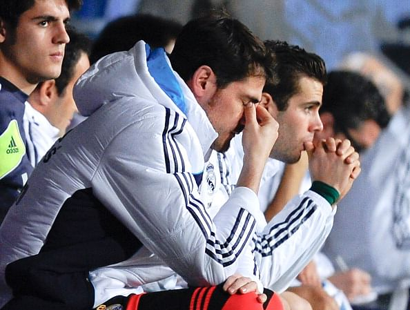 MALAGA, SPAIN - DECEMBER 22:  Iker Casillas of Real Madrid CF reacts dejected on the bench after Roque Santa Cruz of Malaga CF scored his team