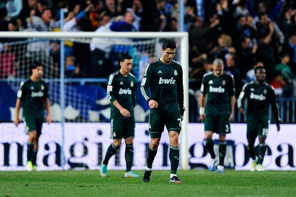MALAGA, SPAIN - DECEMBER 22:  Cristiano Ronaldo of Real Madrid CF reacts dejected afte Roque Santa Cruz of Malaga CF scored his team