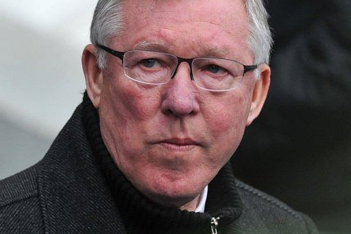 Manchester United manager Alex Ferguson at his side