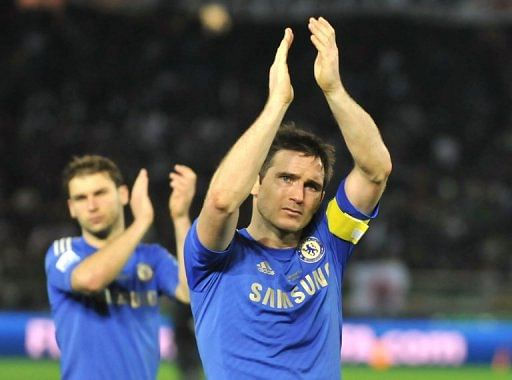 Frank Lampard acknowledges Chelsea fans after losing the Club World Cup final in Yokohama, Japan on December 16, 2012